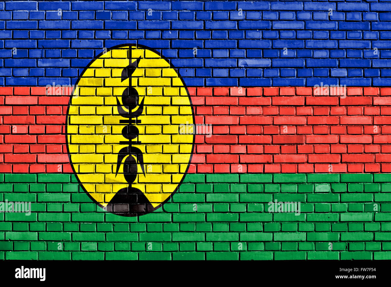 flag of New Caledonia painted on brick wall - Stock Image