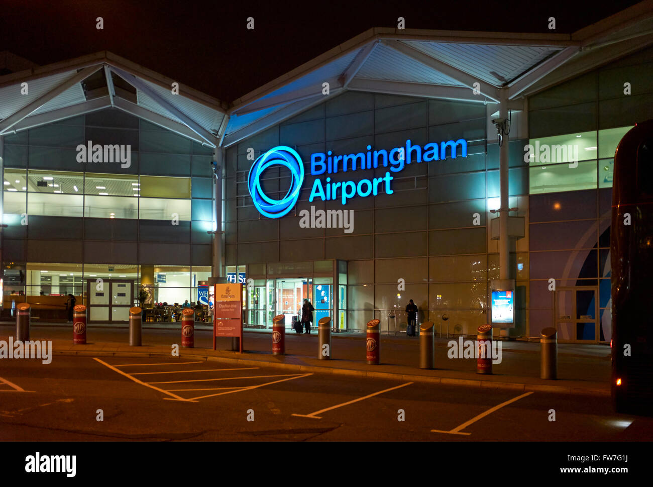 Birmingham airport at night with logo Stock Photo