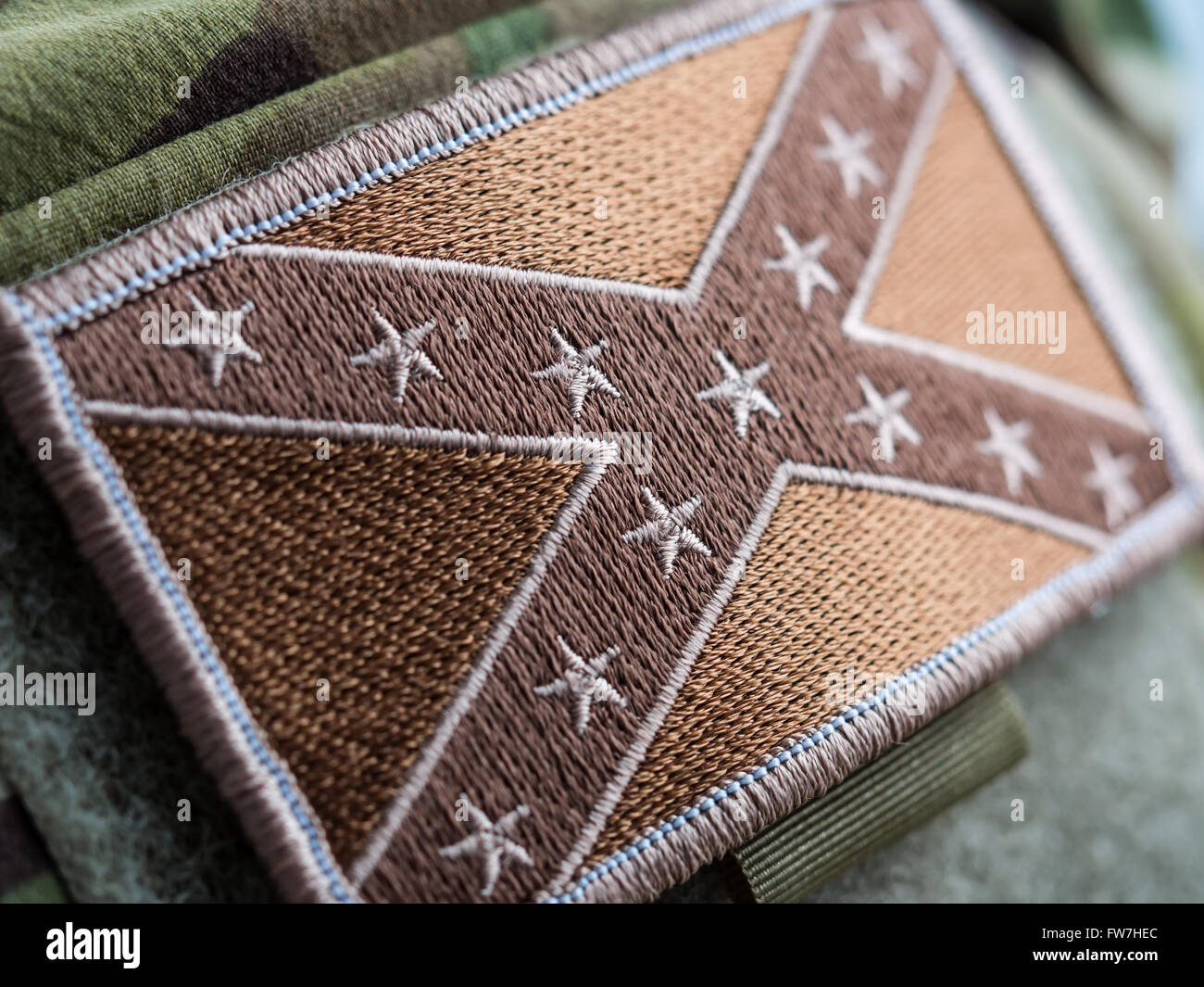 Green toned Combat Confederate Flag patch close-up, shallow depth of field - Stock Image