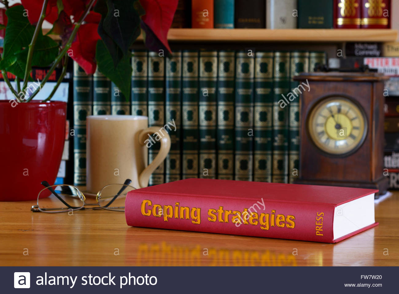 Coping strategies book title, stacked used books, England - Stock Image