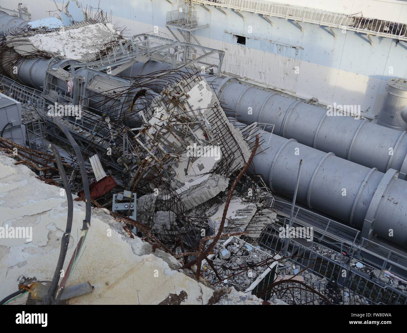 Debris in front of the remains of Unit 4 upper levels at the Fukushima Daiichi Nuclear Power Station December 18, - Stock Image