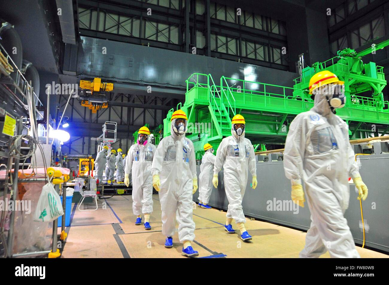 IAEA experts visit the Fukushima Daiichi Nuclear Power Station to view the fuel assembly removal process in Reactor - Stock Image