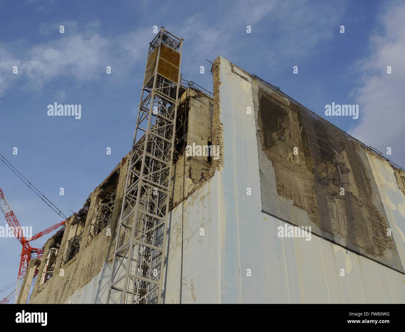 The remains of Unit 4 upper levels at the Fukushima Daiichi Nuclear Power Station December 18, 2012 in Okuma, Japan. - Stock Image