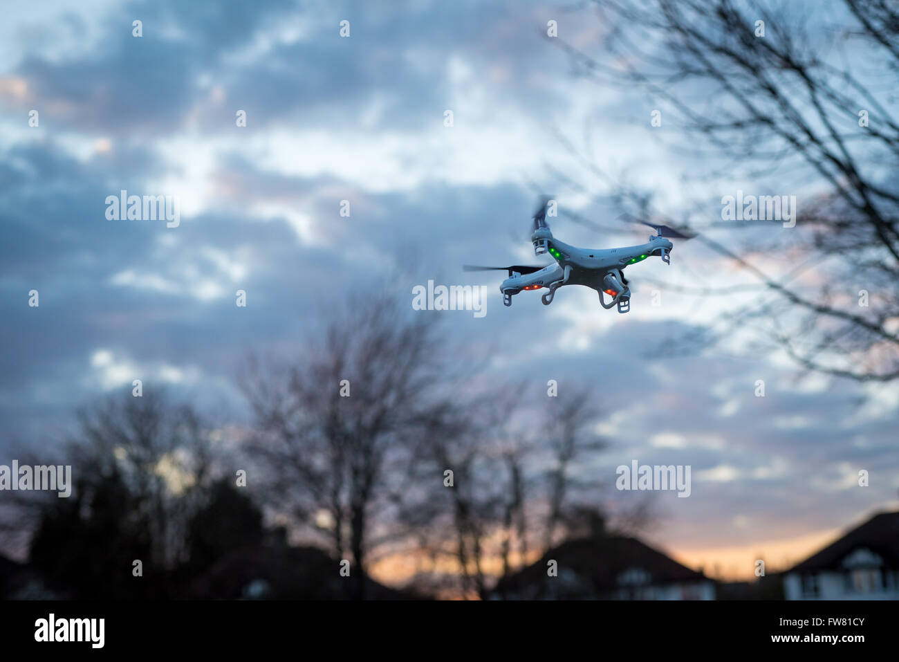 A man flies a quadcopter, or drone, in a park in Oxford, UK - Stock Image