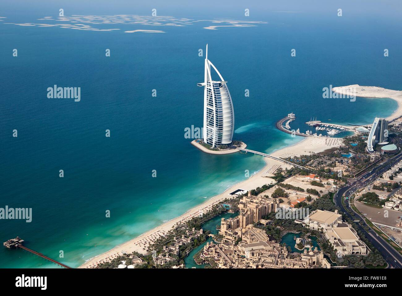 Aerial view of the luxury hotel Burj Al Arab in Dubai, United Arab Emirates. Burj Al Arab stands on an artificial - Stock Image