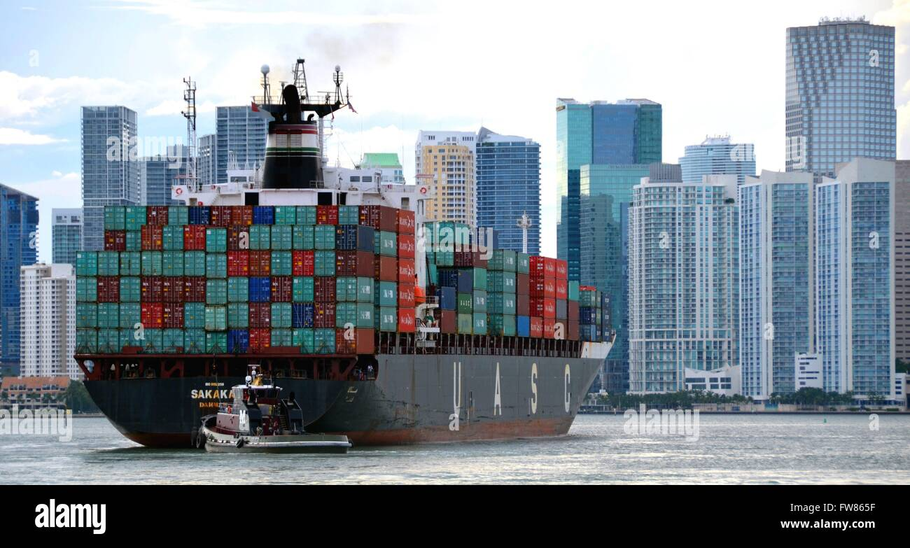 A loaded container ship of the shipping company UASC in the harbour of Miami, Florida. The United Arab Shipping - Stock Image