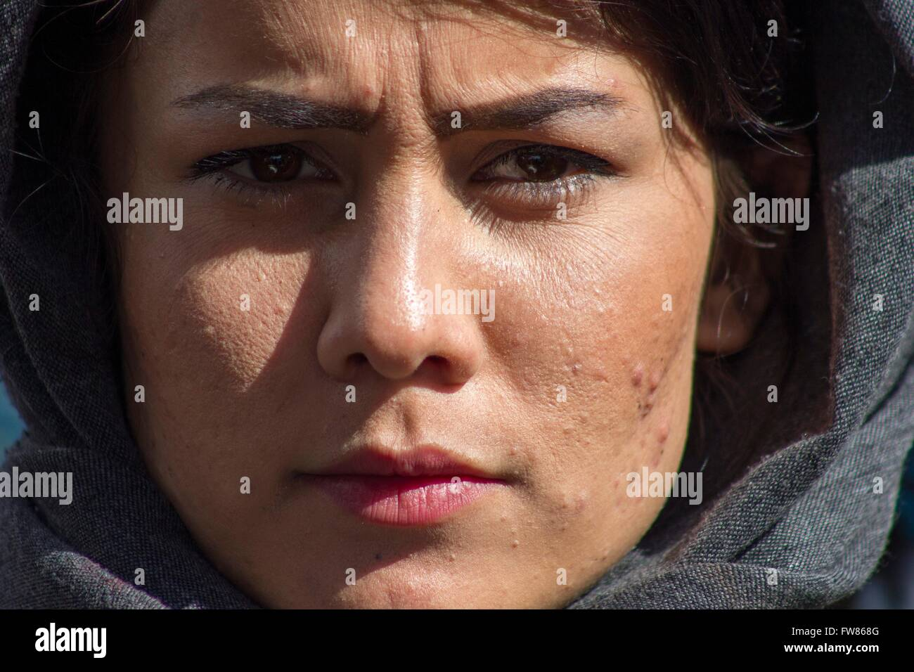 Afghan refugee woman at habour of Piraeus. Refugees demand opening of Greek-Mazedonian border. For weeks refugees - Stock Image