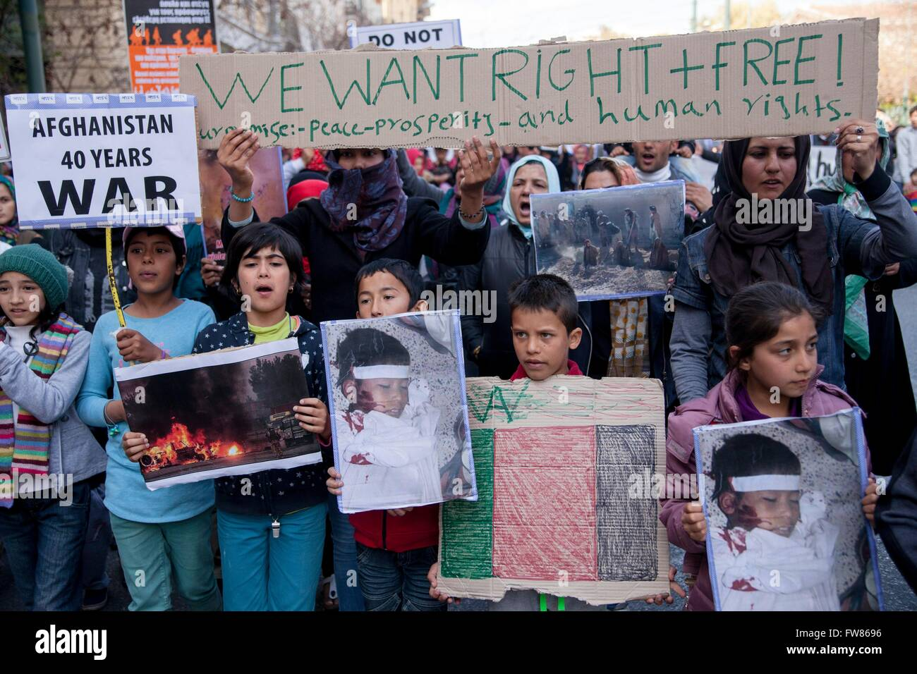 Afghan refugees protest in Athens against closed European borders. Sign demanding 'Rights and Freedom'. - Stock Image