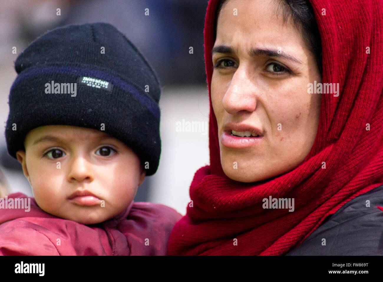 Afghan mother with child at habour of Piraeus. Despite difficulties refugees remain at habour of Piraeus, hope for - Stock Image