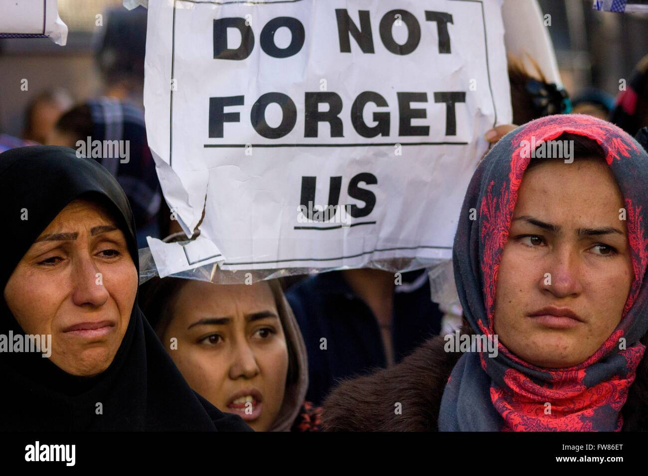 Afghan refugees protest in Athens against closed European borders. Sign 'Don_t forget us'. Refugees demand - Stock Image