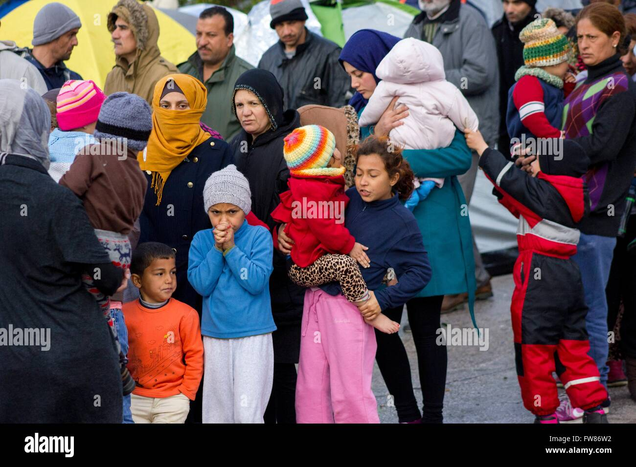 Refugees at habour of Piraeus. Despite ability to move to a camp and closed European borders, refugees remain at - Stock Image