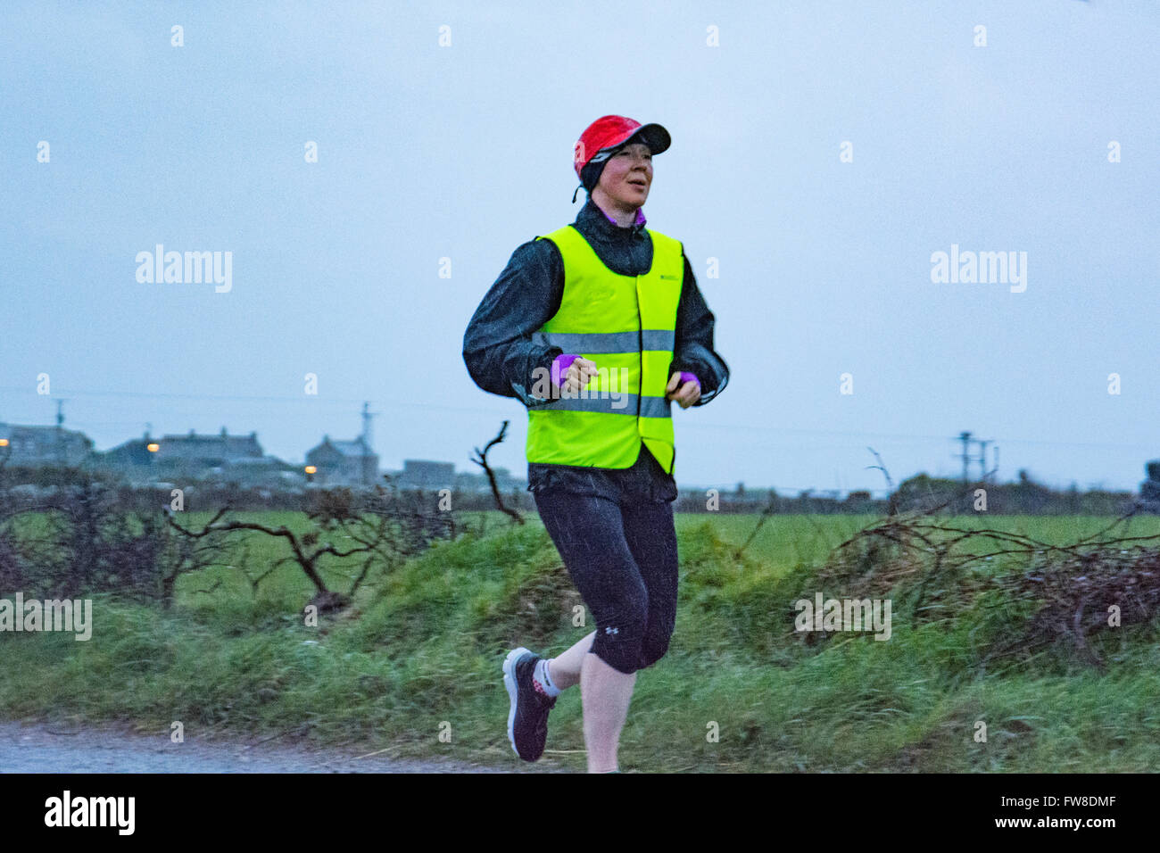 Lands End, Cornwall, UK. 2nd April 2016. Yvie Johnson setting off from a wet Lands End in her attempt to set the - Stock Image