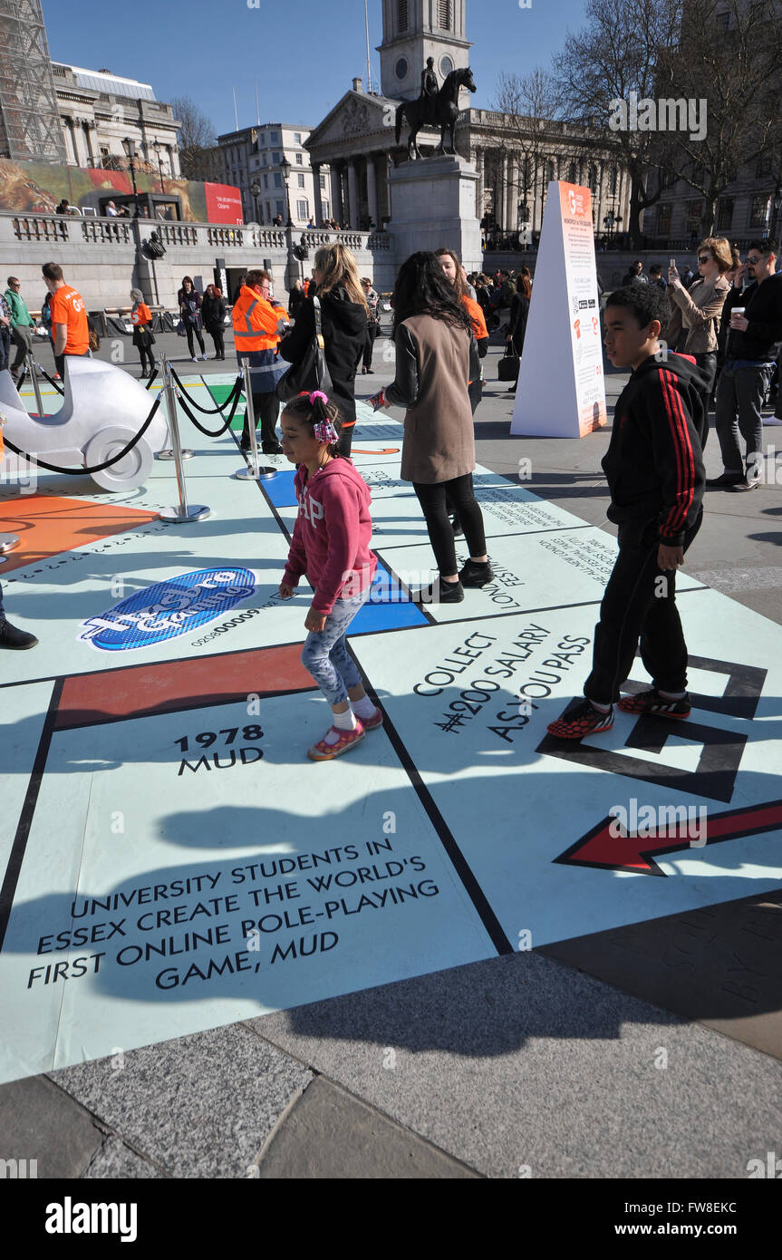 Large Monopoly board set up in Trafalgar Square as part of London Games Festival. The public play on the board using - Stock Image