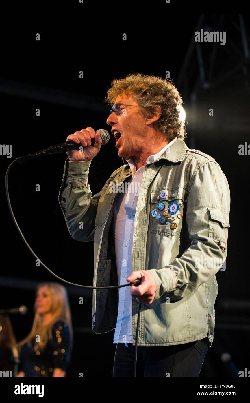 Rock 'n' Horsepower 2014. The Who headlined the event,  Roger  Daltrey  bangs out some of the bands hits - Stock Image