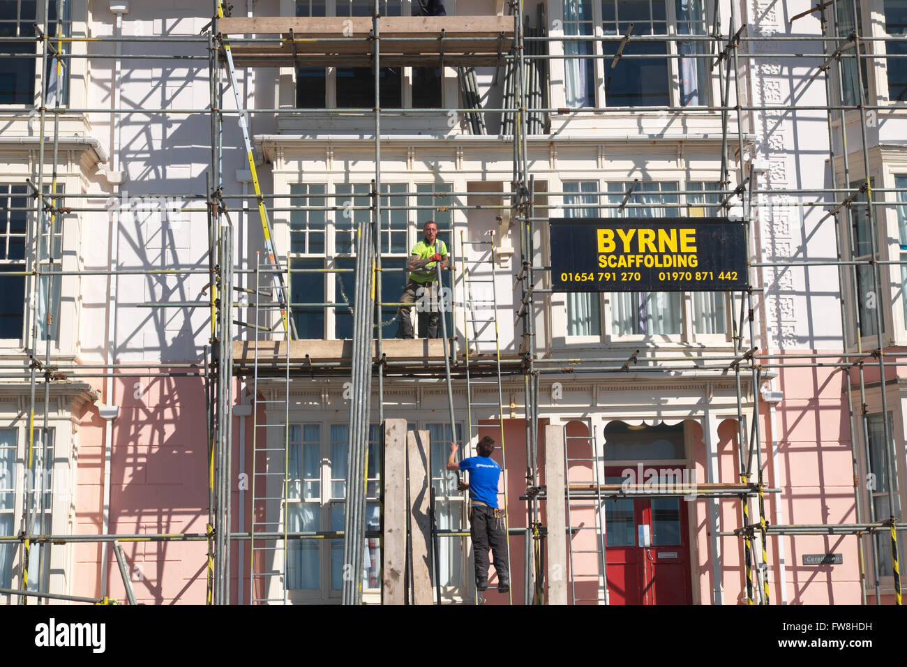 Scaffolders erecting scaffolding in UK - Stock Image