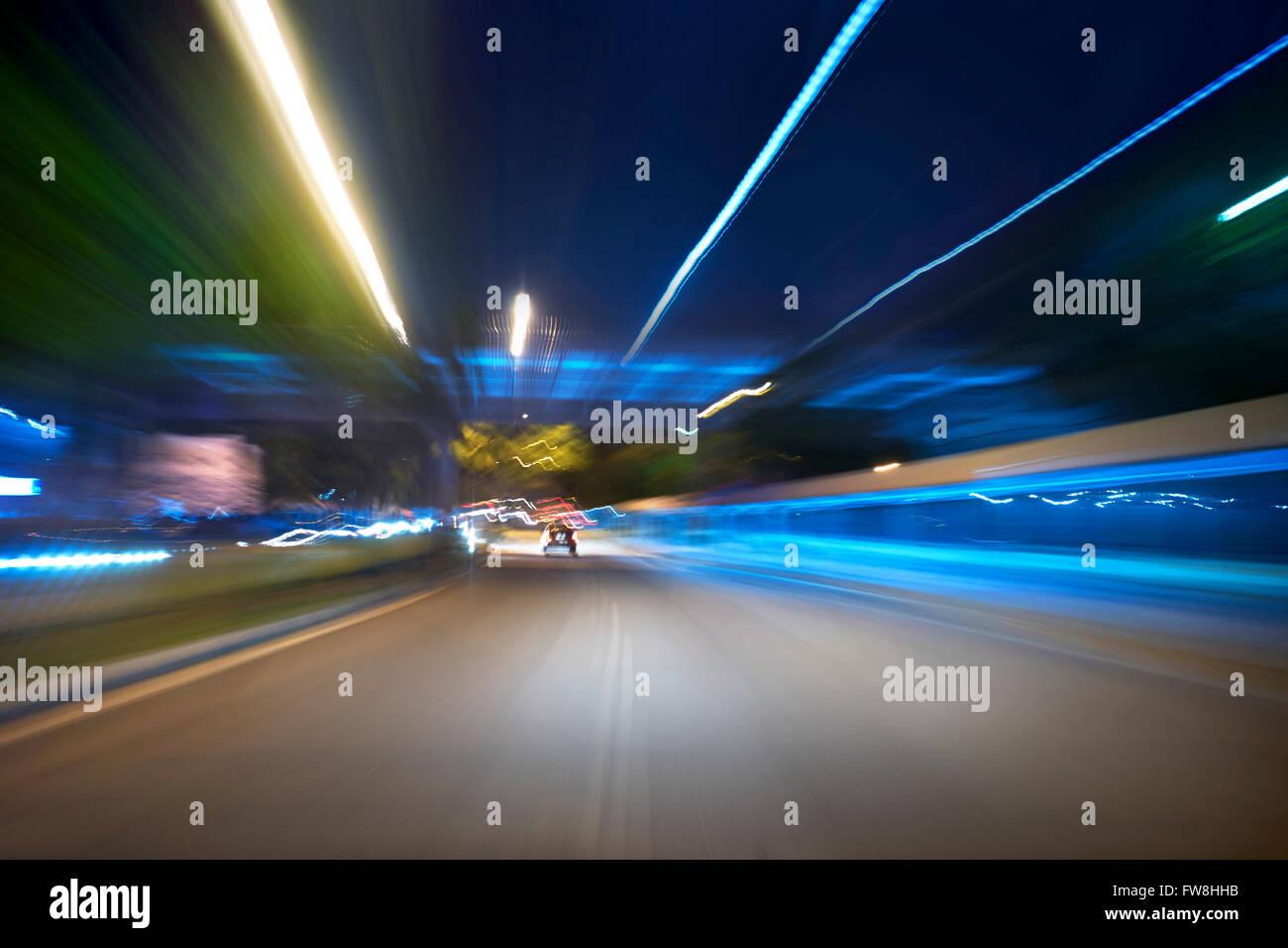 moving forward motion blur background,night scene - Stock Image
