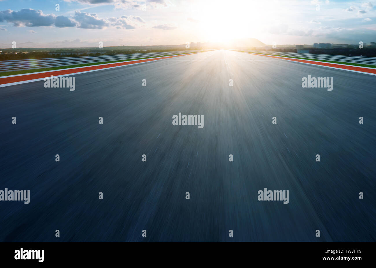 Motion blurred racetrack,morning - Stock Image