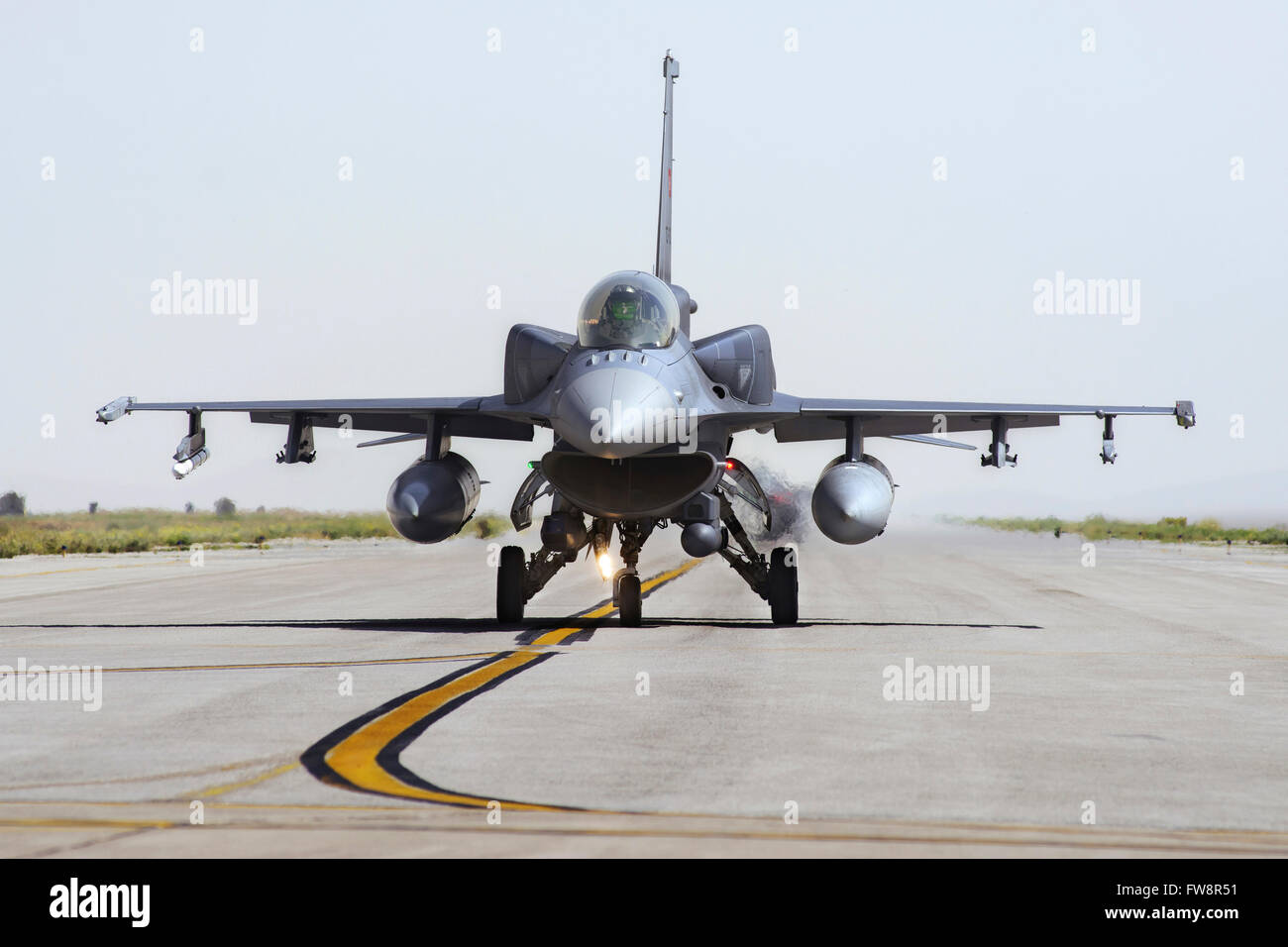 A Turkish Air Force modern F-16D Block 50+ Fighting Falcon equipped with conformal fuel tanks. These fuel tanks - Stock Image