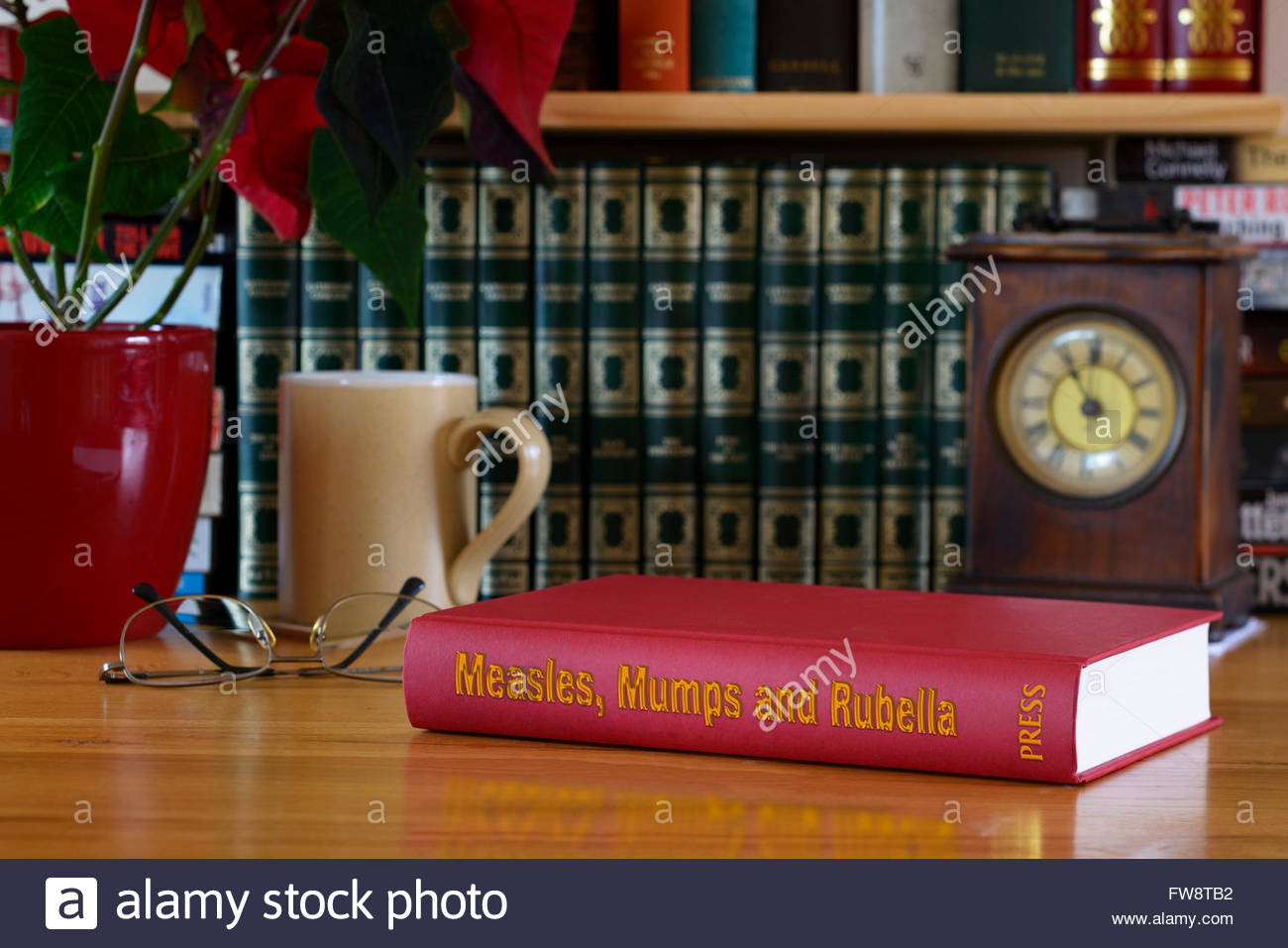 Measles, Mumps and Rubella (MMR) book title on desk, England - Stock Image