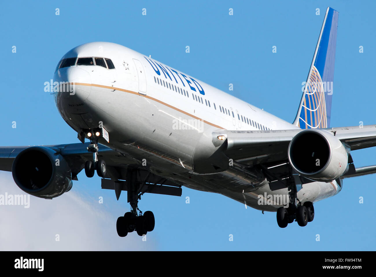 United Airlines Boeing 767-300 approaches runway 27L at London Heathrow airport. - Stock Image