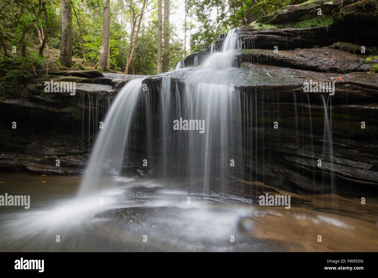 Carrick Creek Waterfall at the beginning of the hike to the top of Table Rock State Park in South Carolina. - Stock Image