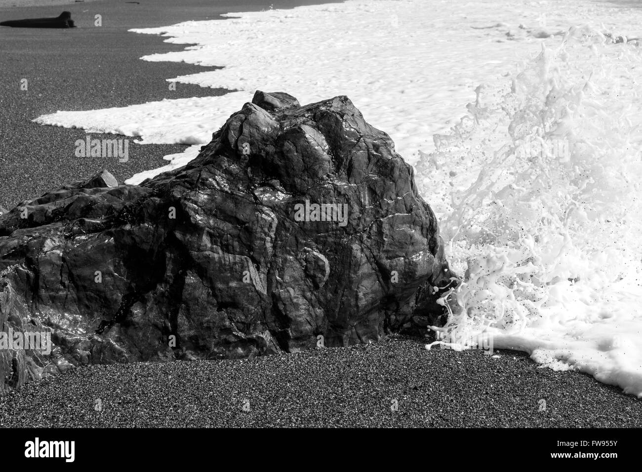 Rock formation with sea foam on beach, Pacific Rim National Park Reserve, Tofino, Vancouver Island, British Columbia, Stock Photo