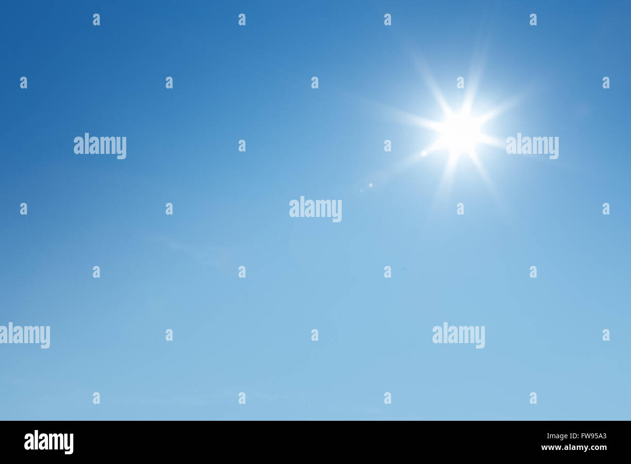 The sun shines bright in the daytime in summer. - Stock Image