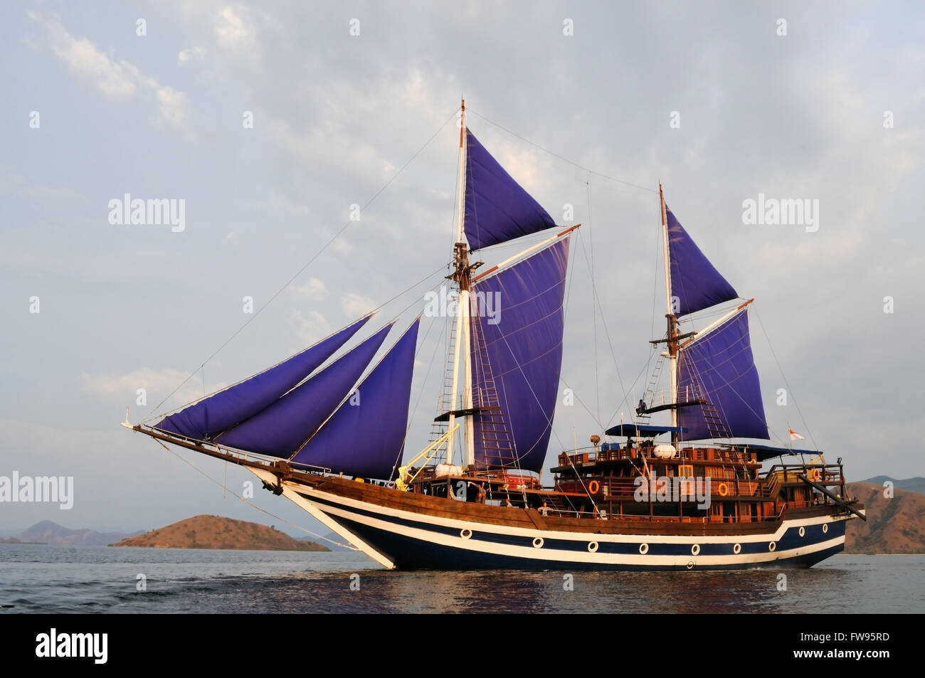 Sailboat with hoisted sails, Indonesia - Stock Image