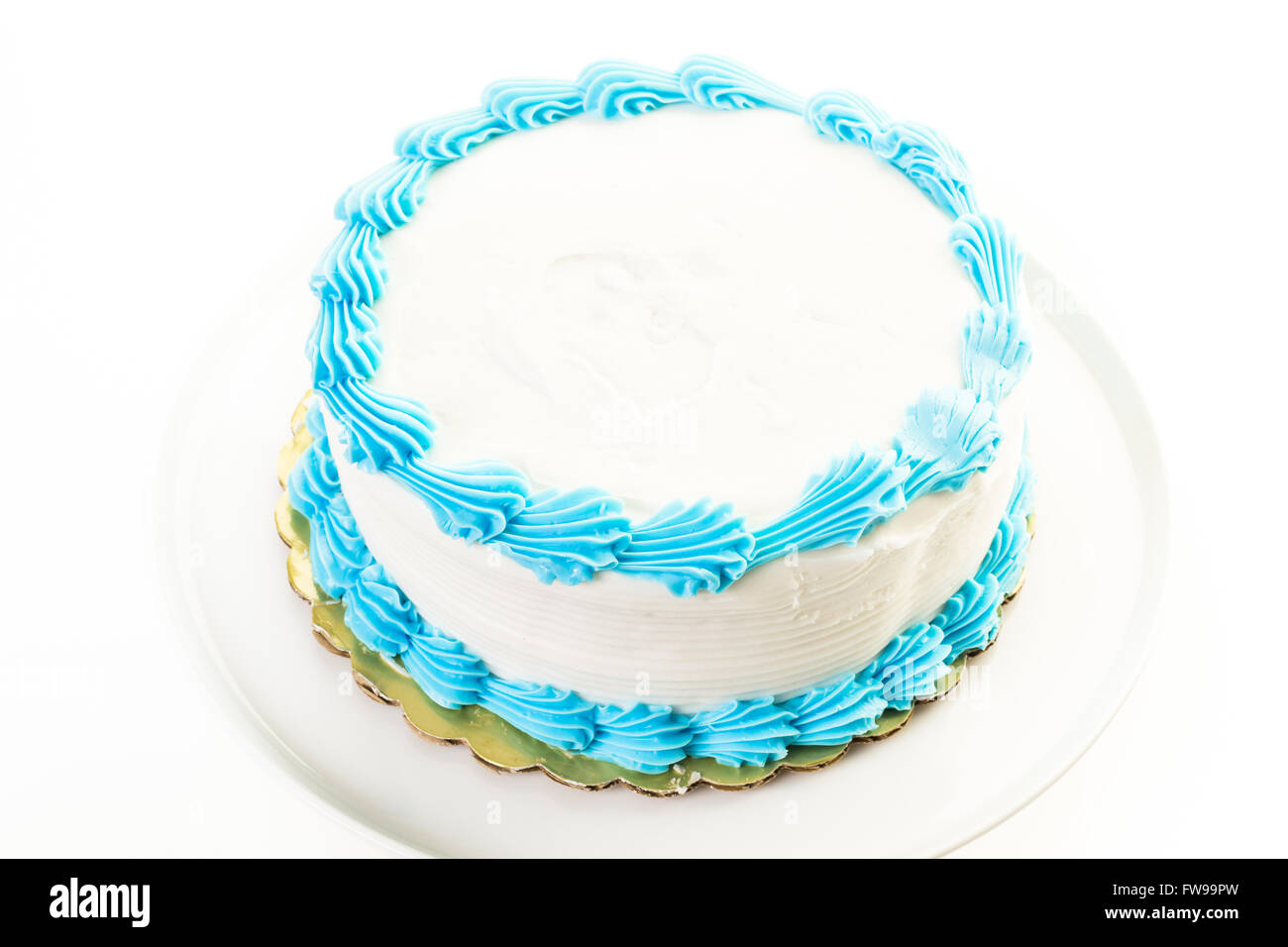 Simple white Birthday cake with white and blue icing Stock Photo
