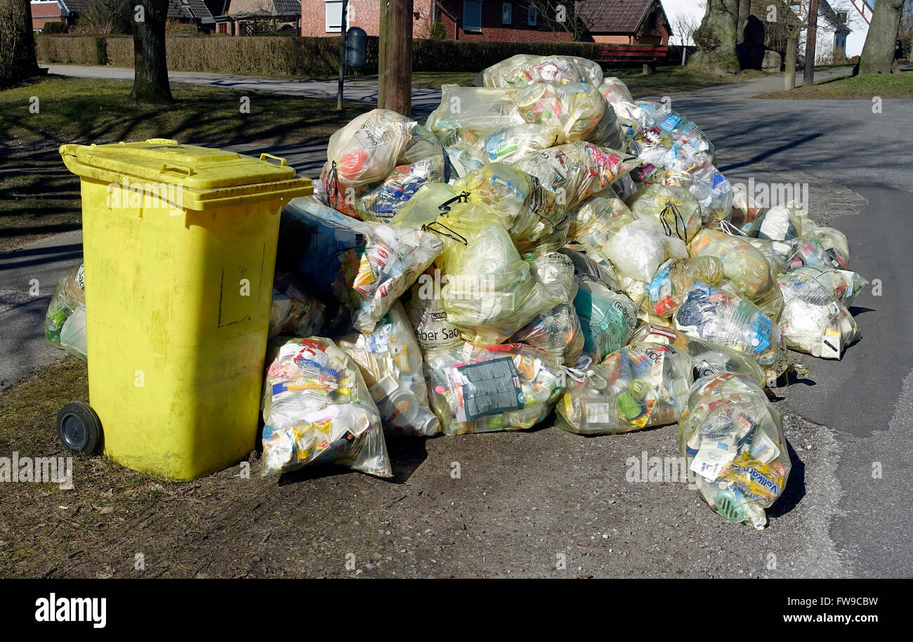 Accumulation of garbage bags, recycling sacks, yellow bags, ready to be picked, Kiel-Oppendorf, Schleswig-Holstein, - Stock Image