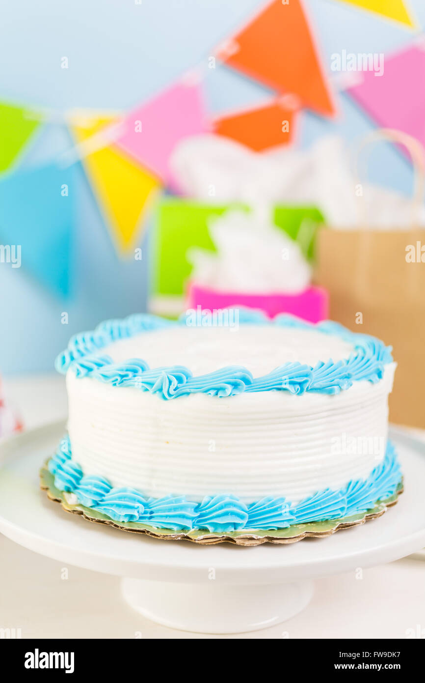 Sensational Simple White Birthday Cake With White And Blue Icing Stock Photo Funny Birthday Cards Online Elaedamsfinfo