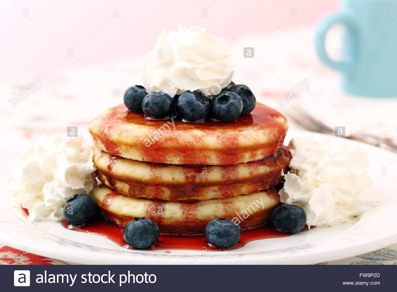 pancakes with fresh blueberries and cram for breakfast horizontal - Stock Image