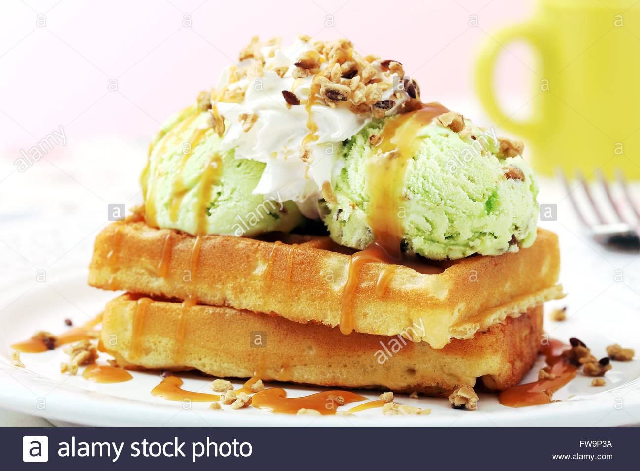 waffles with ice cream on kitchen table background - Stock Image