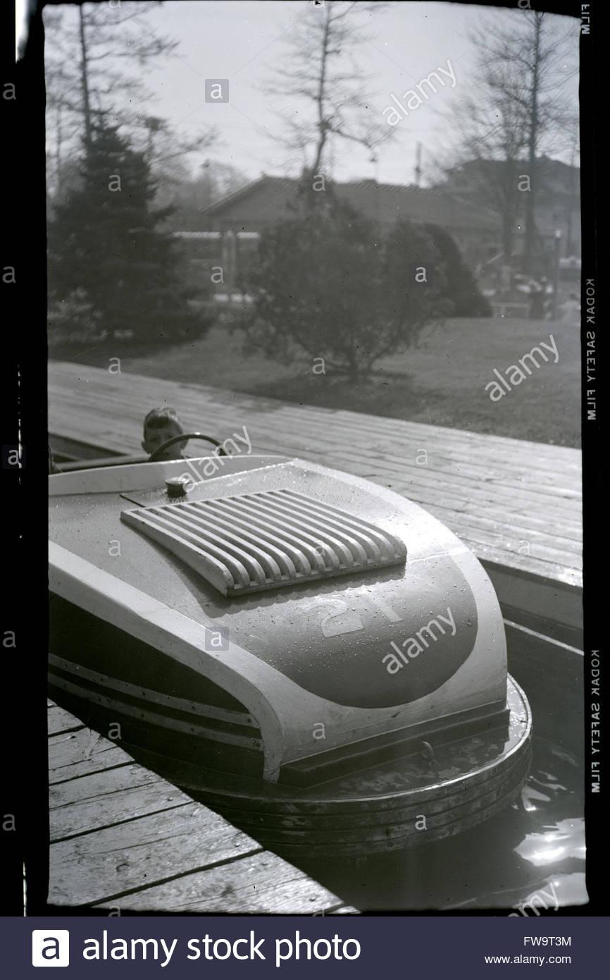 boy in bumper boat car 1950s USA amusement park - Stock Image