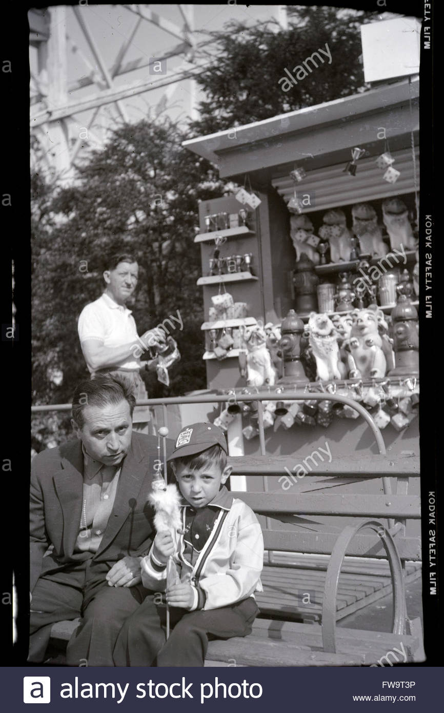 father posing with son on a day outing at a fairground USA 1950s - Stock Image