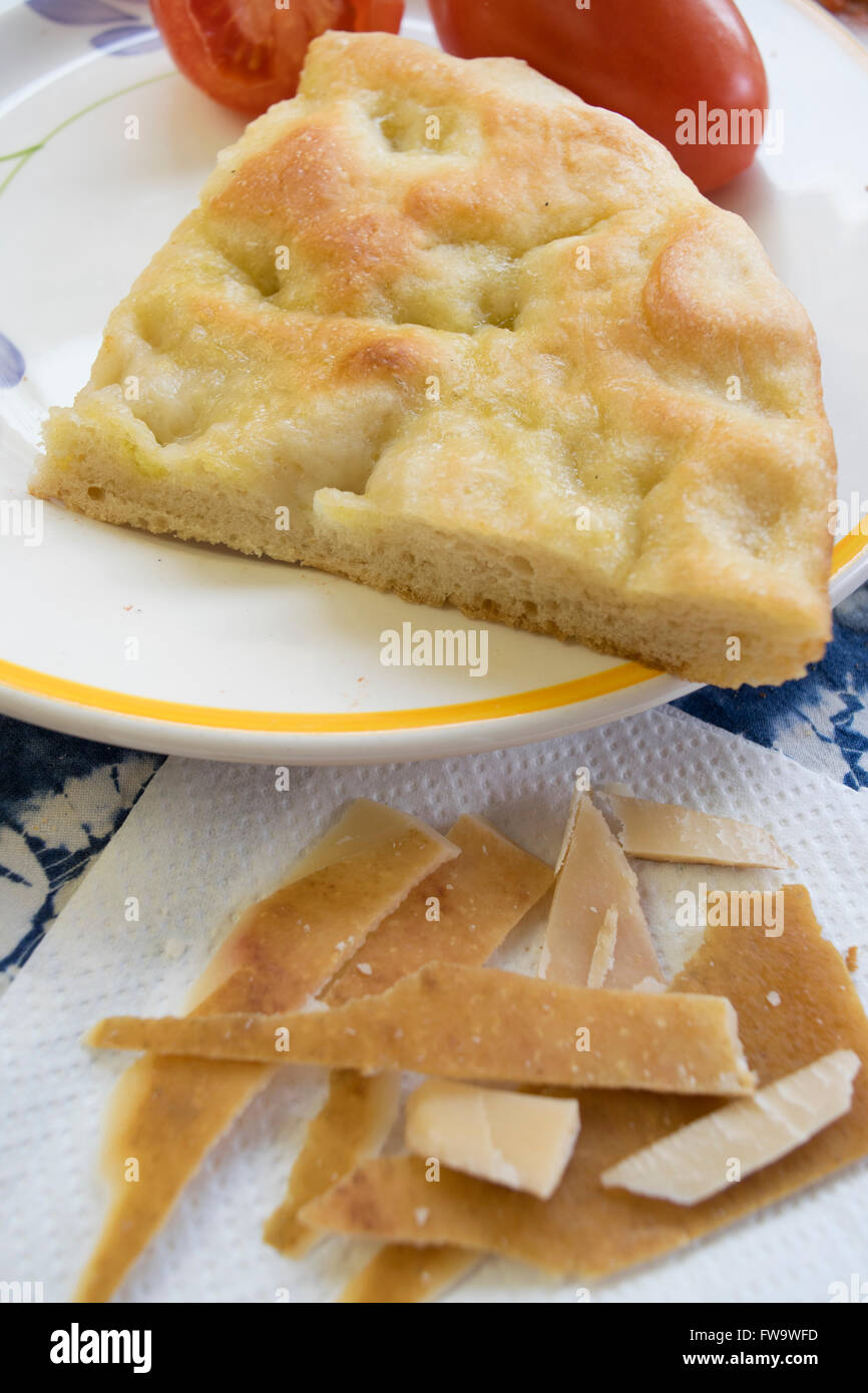 cheese rind homemade focaccia and fresh tomatoes - Stock Image
