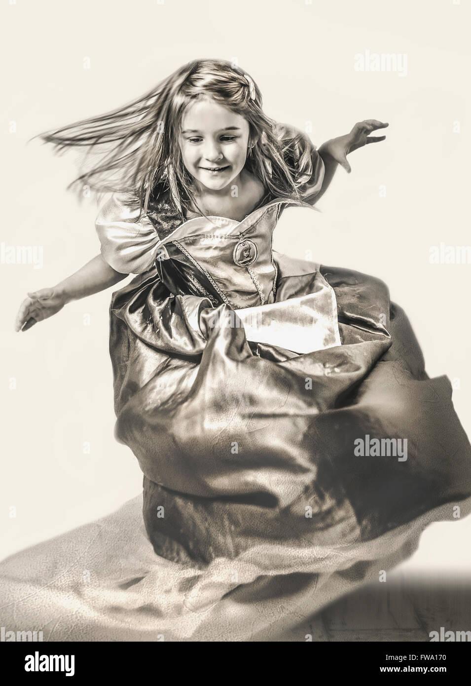 young girl dancing in long dress Stock Photo