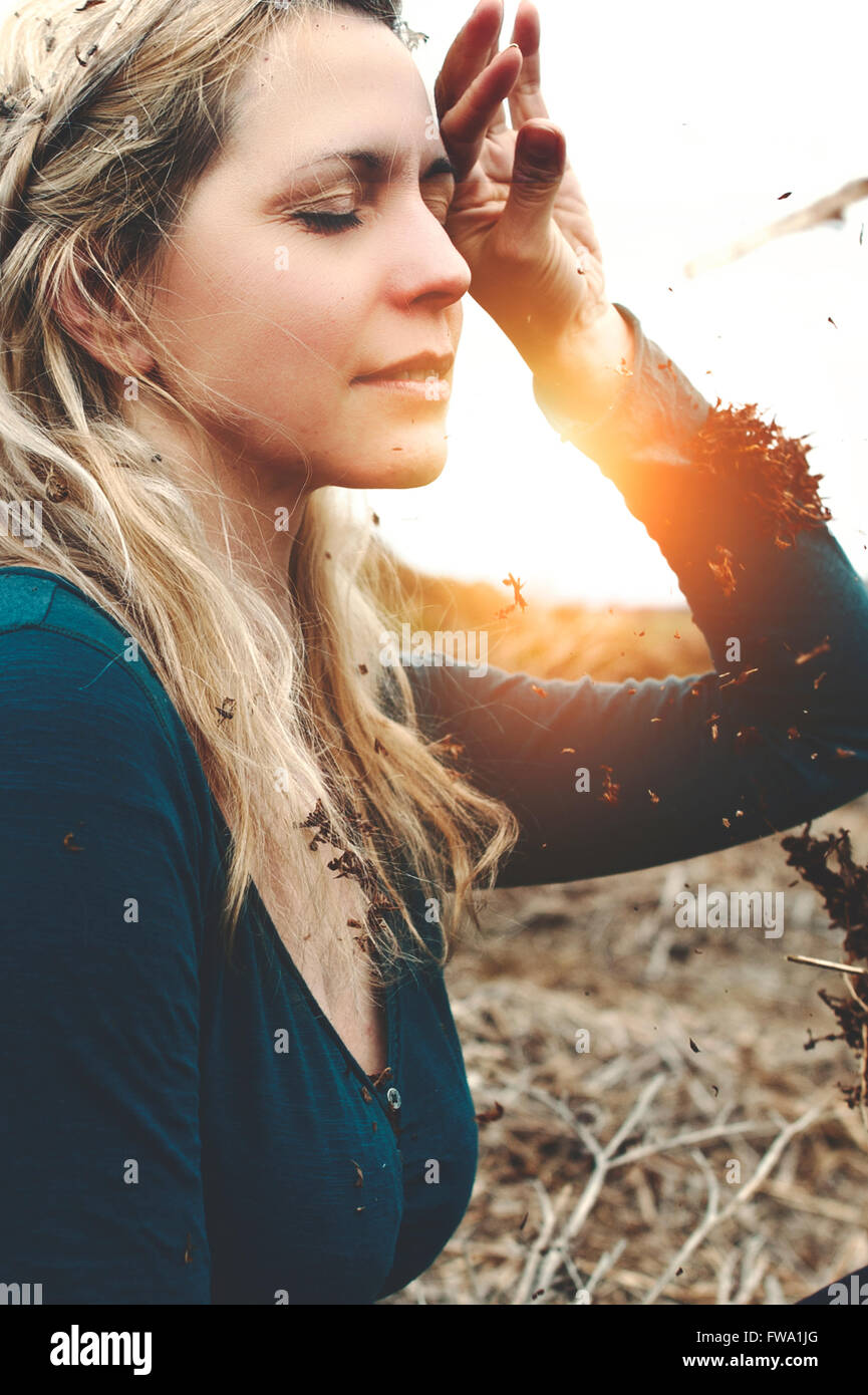portrait of the young beautiful woman dreaming in nature - Stock Image