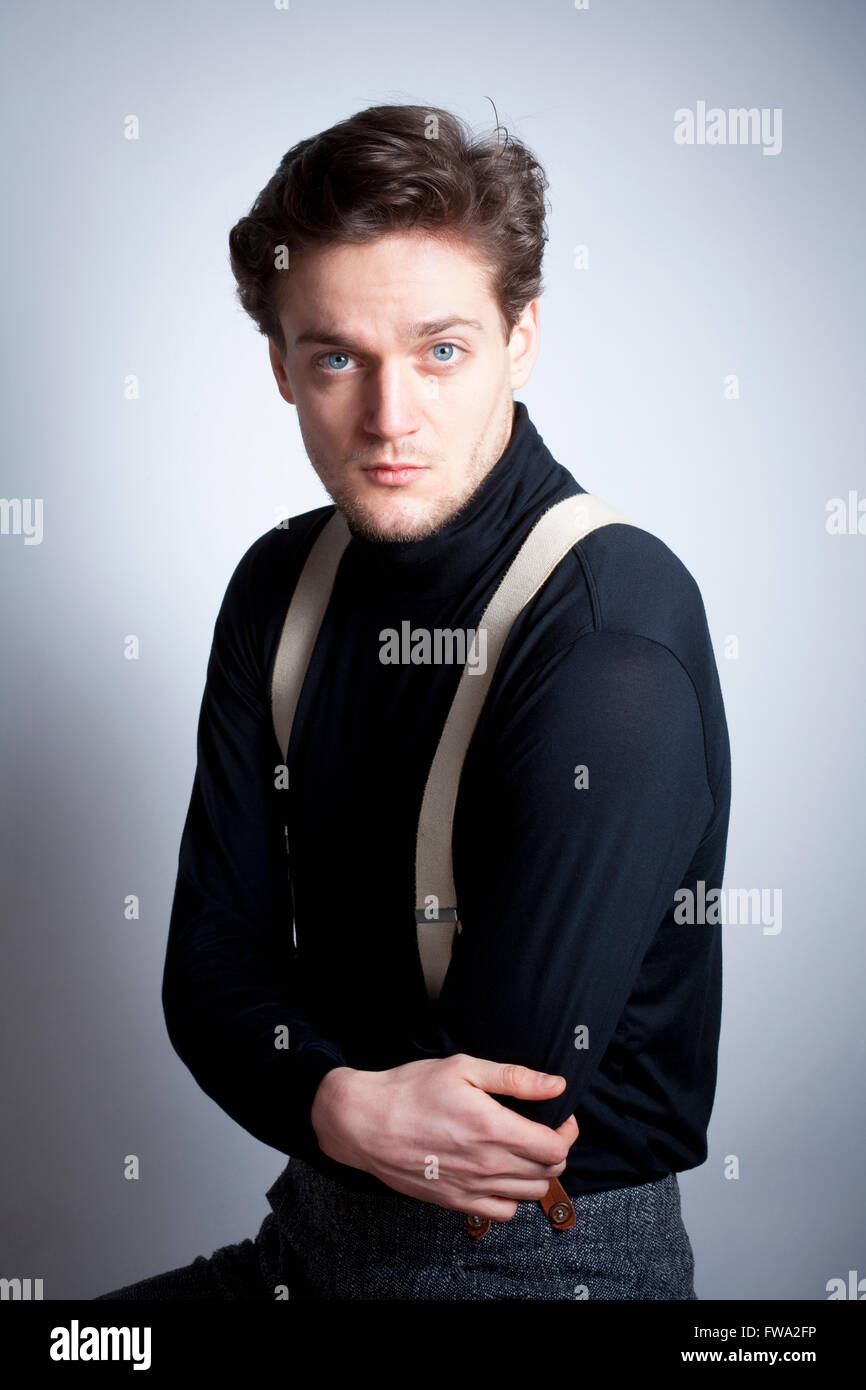 Portrait of a Young Man with Brown Hair with Suspenders. - Stock Image