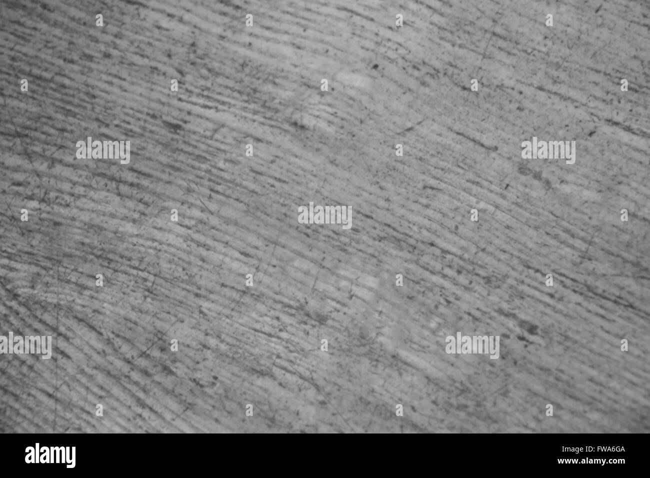 Old wooden table surface showing a well used texture - Stock Image