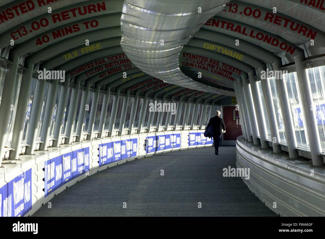 passenger,traveler, business man in airport tunnel - Stock Image