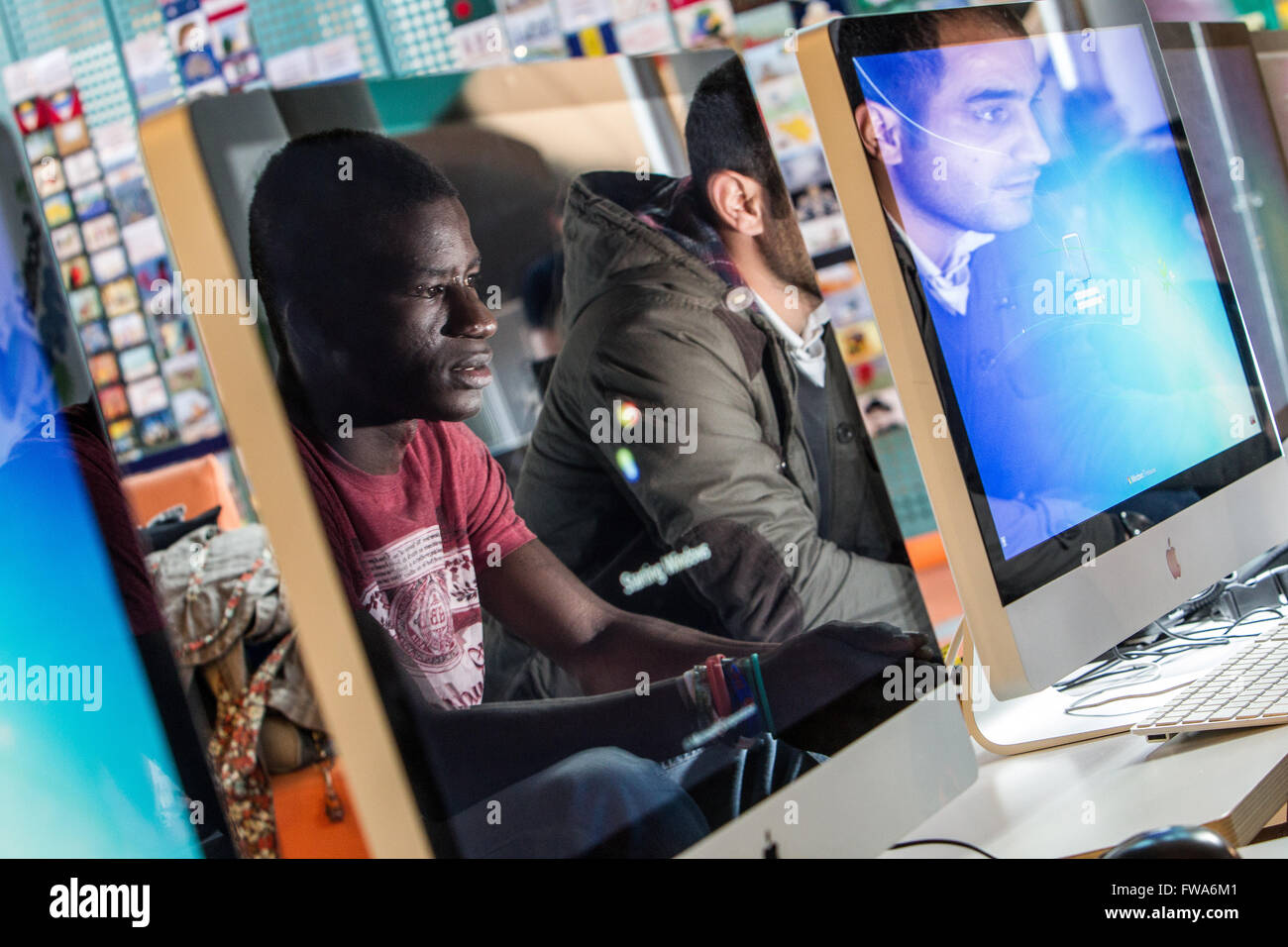 students reflected on computer screens - Stock Image
