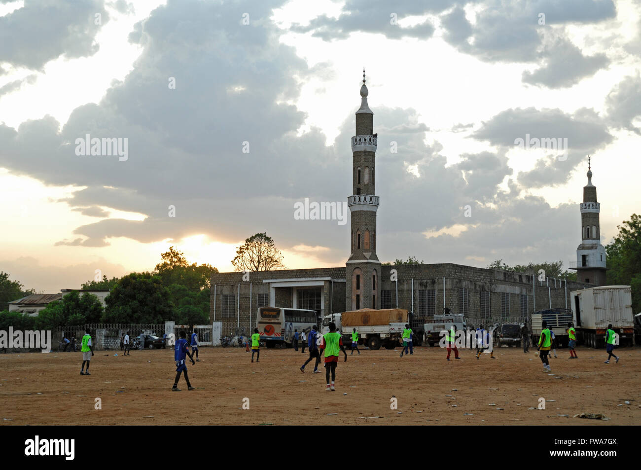 Youngsters playing football, by Mosque, in Juba, South Sudan. - Stock Image