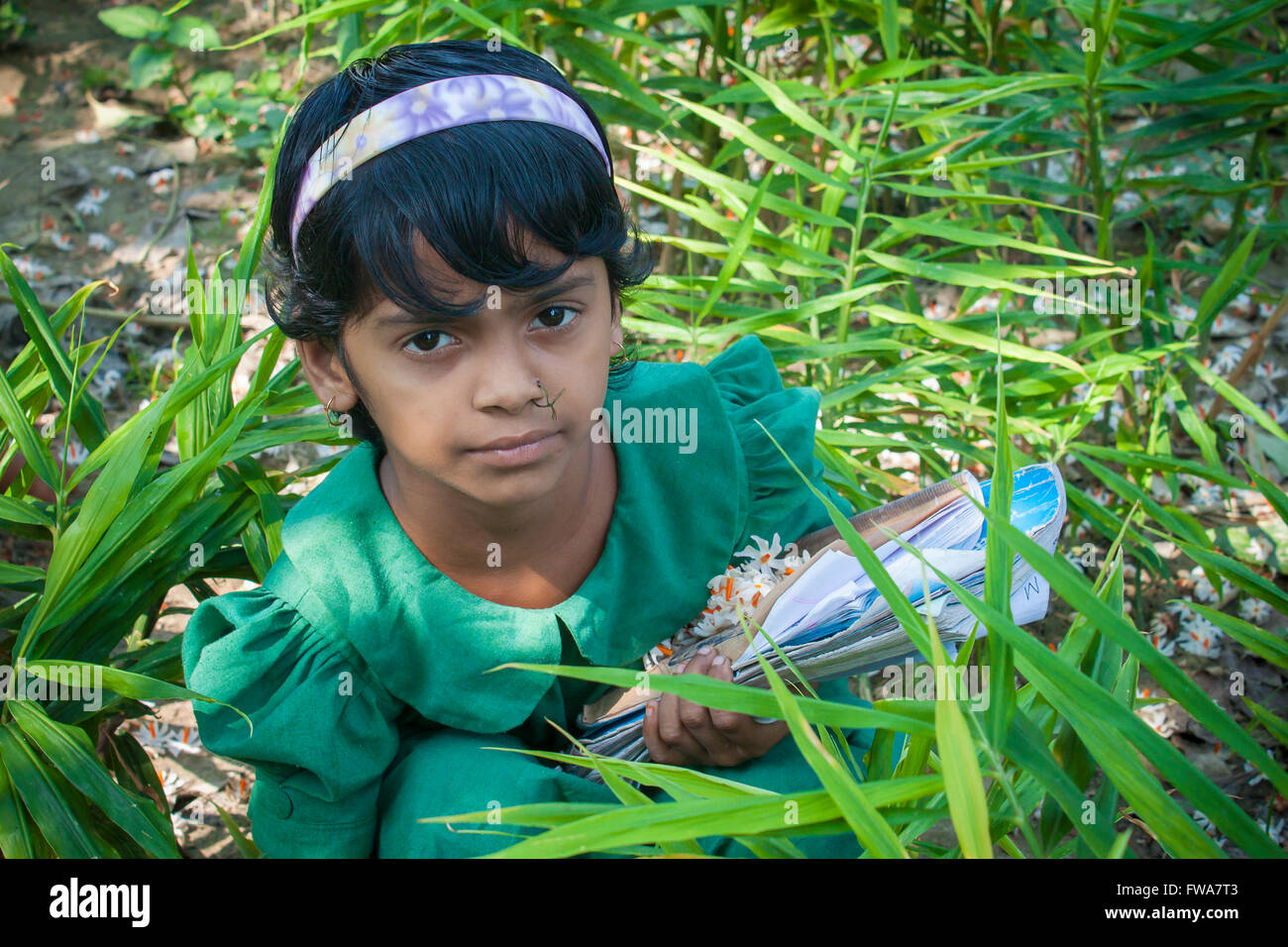 A school kid Jasmine (Flower) Collecting in SSS (Society for Social Service) Center, Tangail, Dhaka, Bangladesh - Stock Image