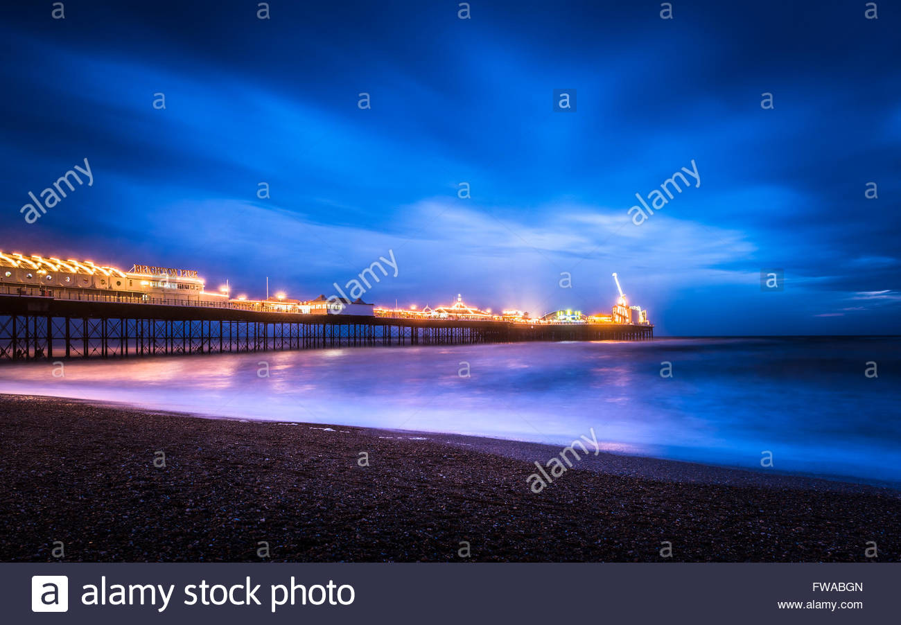 Brighton Pier after the sun had set on a windy winters day. - Stock Image