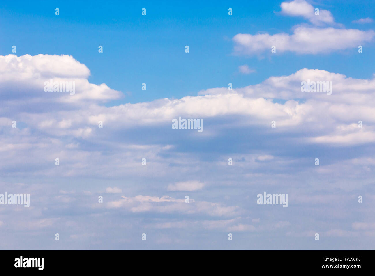 blue sky with fluffy clouds in daylight - Stock Image