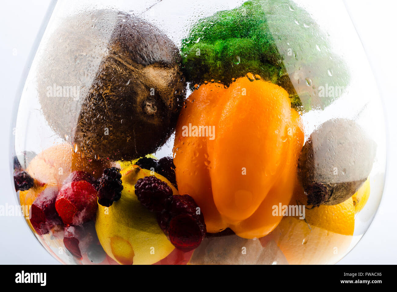 aquarium with healthy food, fruits, vegetables and berries (strawberries, strawberry, raspberry, coconut, broccoli, - Stock Image