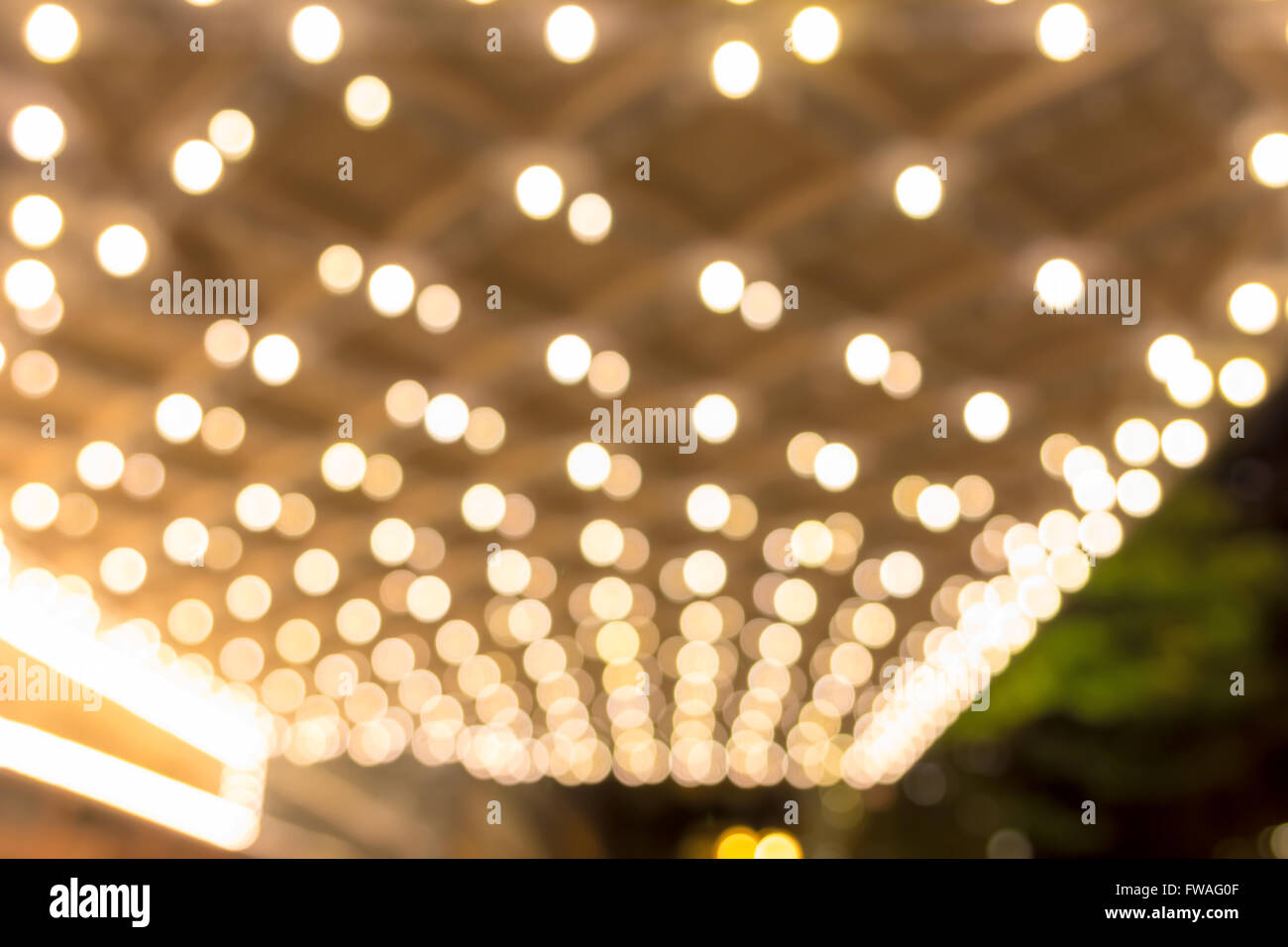 blurred defocused bokeh marquee lights on theater entrance ceiling