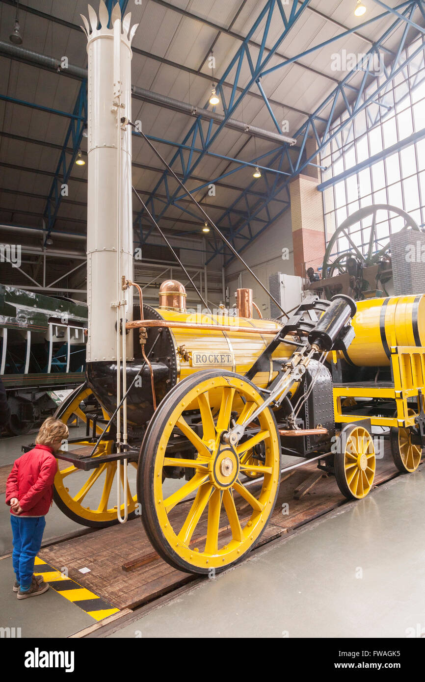 A copy of George Stephenson's Rocket at the National Railway Museum at York, North Yorkshire, England, UK. Some - Stock Image