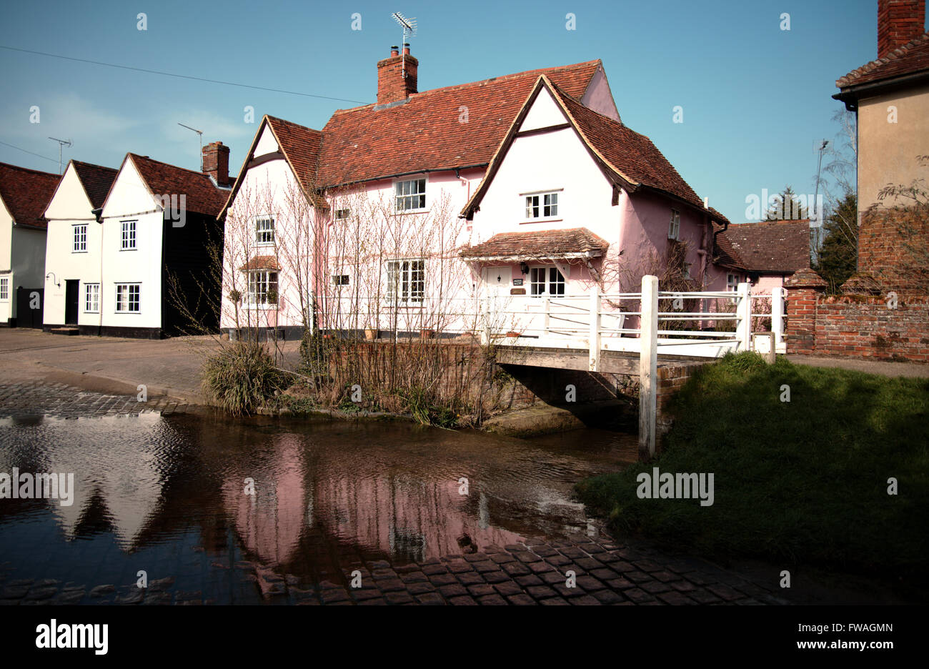 Reflections in a river at Kersey, Suffolk, England. A footbridge over a river ford in a sleepy English village - Stock Image